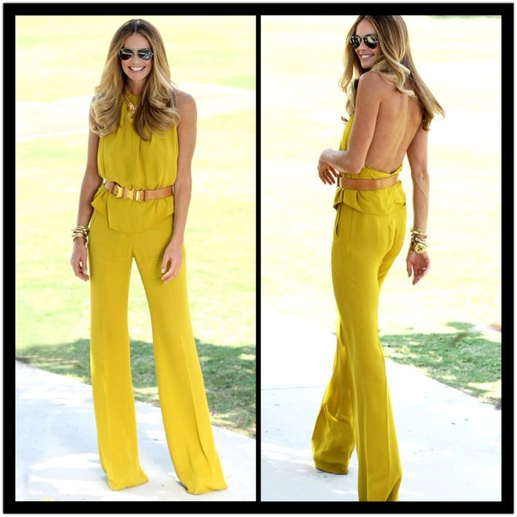elle macpherson wearing a yellow jumpsuit summer fashion star